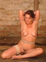 Mature woman in intense bondage
