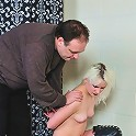 Blond slave in leather getting tied up
