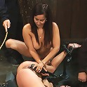 One girl is stretched to the limit of her body The other takes the cane and takes it hard!