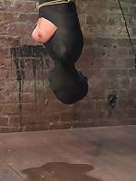 Cute little blond girl is mummified, vibrator stuck on her clit. Hung upside down to cum & cum.